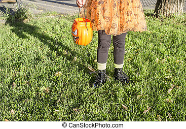 Little girl in halloween costumes in the park