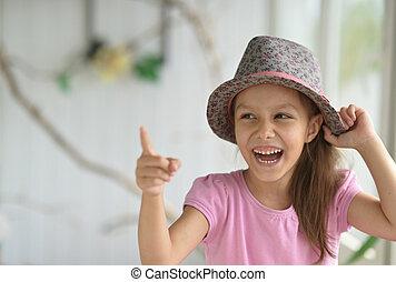 Little girl in hat posing