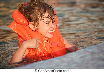 little girl in inflatable waistcoat in pool - little girl in...