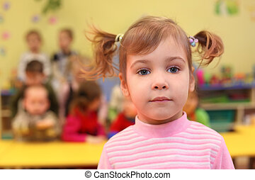 Little girl in kindergarten