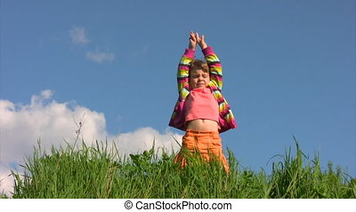 girl in meadow exercising yoga