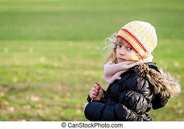little girl in meadow
