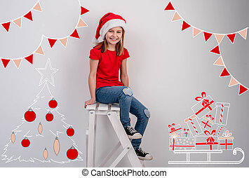 Little girl in middle of christmas drawings