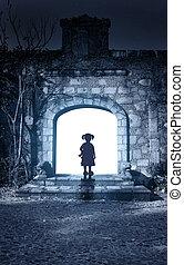Little girl in open door of ancient house