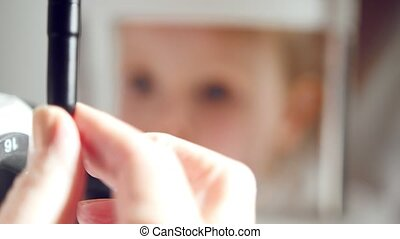 Little girl in ophthalmology clinic - child's ophthalmology - doctor optometrist checks eyesight for