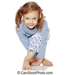 Little girl in pajamas.