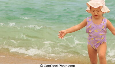 Little Girl in Panama Goes out of Sea Water to Beach -...