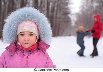 Little girl in park in winter