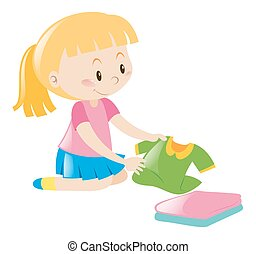 Little girl in pink folding clothes