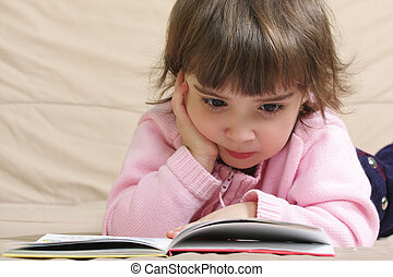 Little girl in pink reading