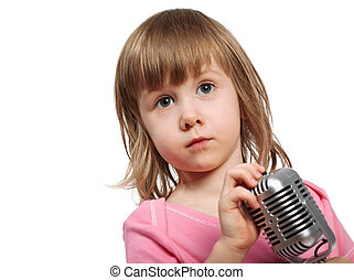 Little girl in pink with microphone.