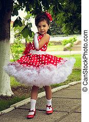 little girl in polka dot dress