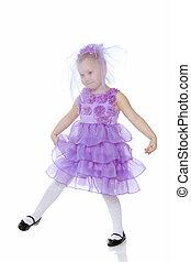Little girl in purple dress.