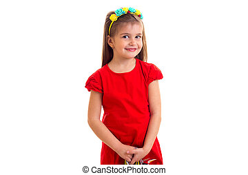 Little girl in red dress at white background.