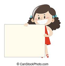 Little girl in red dress holding white board