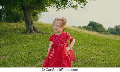 little girl in red dress