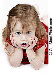 Little girl in red dress with hands on face