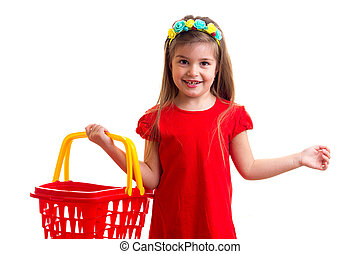Little girl in red dress with shopping basket