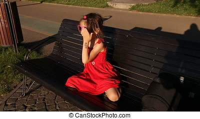 Little Girl in Red Fun with Sunglasses