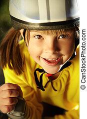 Little girl in roller skates at a park