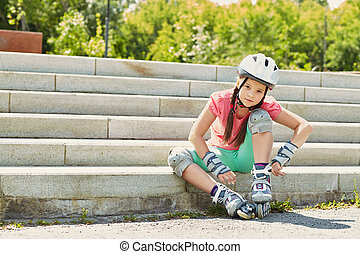 Little girl in roller skates