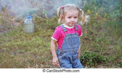 Little girl in sandbox