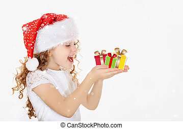 Little girl in Santa hat, hold christmas gift in his hand