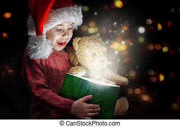 Little girl in Santa's hat
