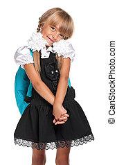 Little girl in school uniform