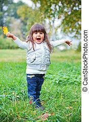 little girl in silver walking park.