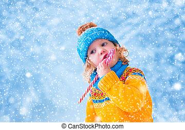 Little girl in snowy park