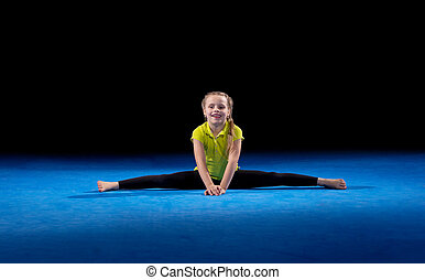 Little girl in sports hall isolated