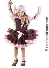Little girl in studio jumping