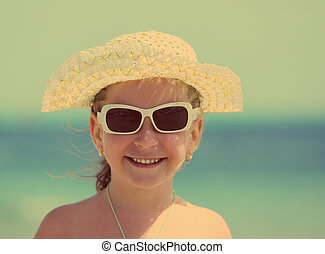 little girl in sunglasses and hat - vintage retro style