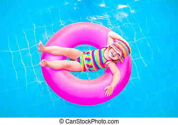 Little girl in swimming pool - Cute funny little toddler ...