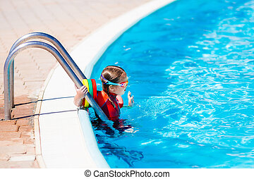 Little girl in swimming pool - Happy laughing little girl...
