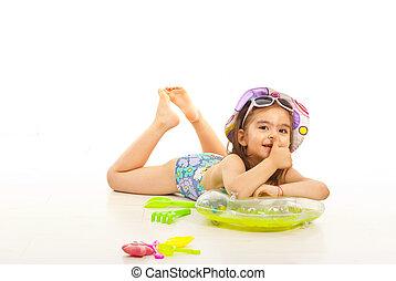 Little girl in swimsuit give thumb - Little girl in swimsuit...