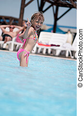 Little girl in swimsuit - Happy little girl in swimsuit...