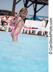 Little girl in swimsuit - Happy little girl in swimsuit ...