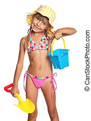Happy little girl in swimsuit with bucket and spade isolated on white background