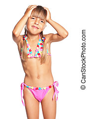 Little girl in swimsuit having a headache, isolated on white...