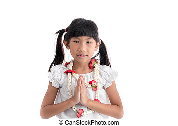 little girl in Thai costume put the palms of the hands together in salute on white background.