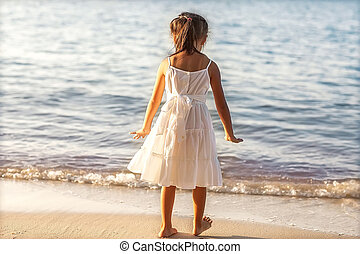 little girl in the beach