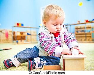 little girl in the classroom early development