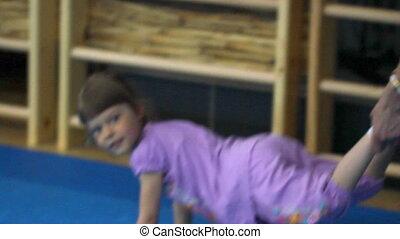 Little girl in the gym