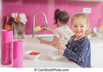 Little girl in the kitchen