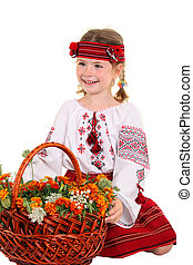Little girl in the national Ukrainian costume sitting on his knees on the white background