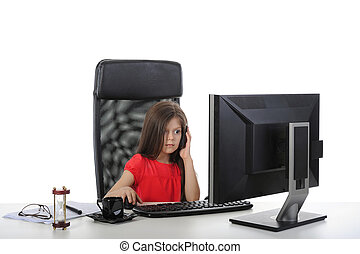 Little girl in the office computer