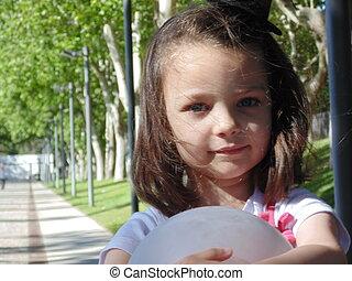 Little girl in the park.