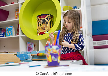 Little girl in the playroom